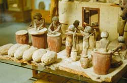 model of egyptians making beer